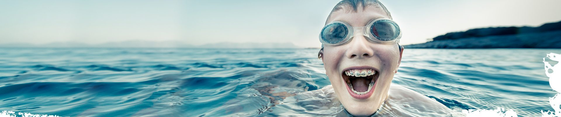Kid Swimming With Braces Finger Lakes Orthodontics